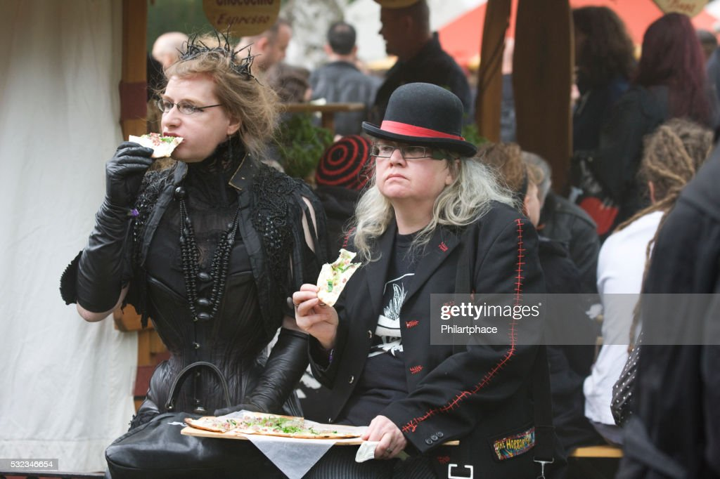 Two Odd Dressed Women Resting And Eating On Wgt Leipzig High Res Stock Photo Getty Images