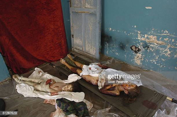 Two of 330 known dead lie in the city mortuary the day after the threeday Russian school siege in Beslan in which Chechen separatists held more than...