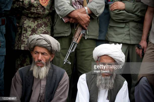Two of a group of more than 100 members of the Taliban surrender themselves to the Afghan Government on August 26 2011 in Badakhshan Afghanistan The...