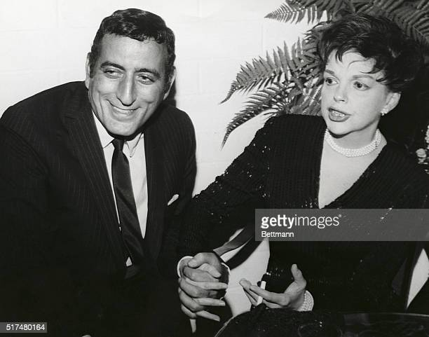 Two of America's great singers meet back stage as the fabulous Judy Garland congratulates singeractor Tony Bennett during a Hollywood supper club...
