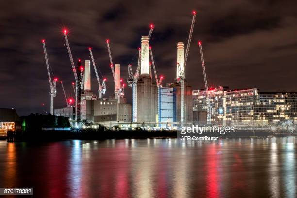 Two of Battersea Power Station's iconic chimneys are lit up for the first time since they were rebuilt on November 4 2017 in London The power station...