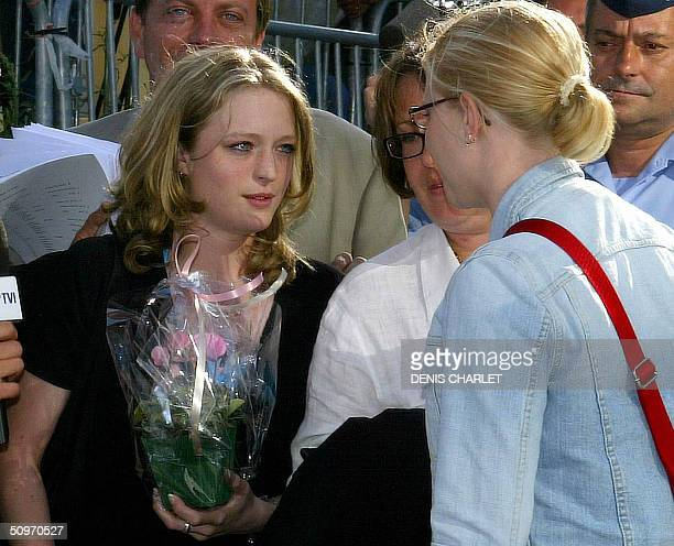 Two of Belgian convicted pedophile Marc Dutroux' victims Sabine Dardenne and Laeticia Delhez leave 17 June 2004 the Arlon courthouse after the...