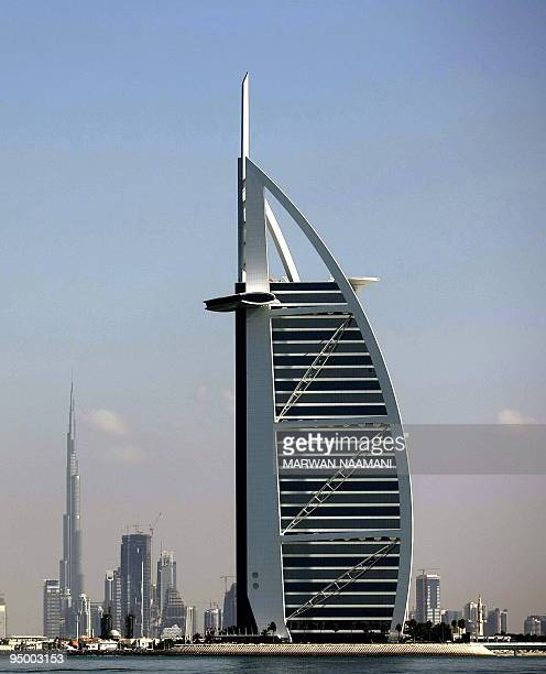 Two of Dubai's most prominent architectural icons Burj anArab Hotel and Burj Dubai are seen along the coast of Dubai on December 21 2009 Dubai's...