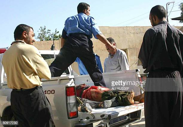 Two of four bodies are seen in the back of a pickup truck following a shooting in the town of Baquba 60 kms northeast of Baghdad 02 June 2004 Four...