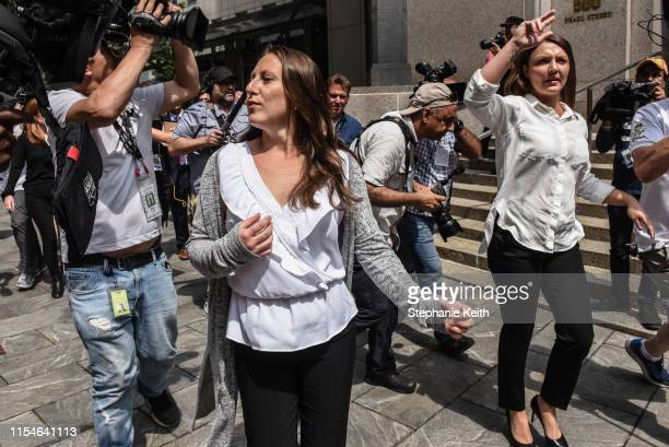 Two of Jeffrey Epstein's alleged victims Michelle Licata and Courtney Wild exit the courthouse after a hearing about billionaire financier Jeffery...