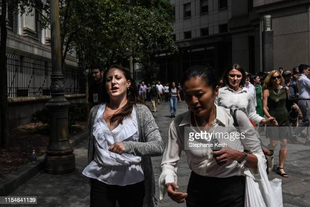 Two of Jeffrey Epstein's alleged victims Michelle Licata and Courtney Wild exit the courthouse after the billionaire financier appeared for a hearing...