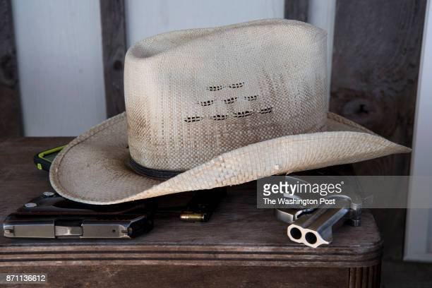 Two of Kevin Langdon's guns sit under his hat at his home in Sutherland Springs Texas on November 6 2017 He knew several of the people killed in the...
