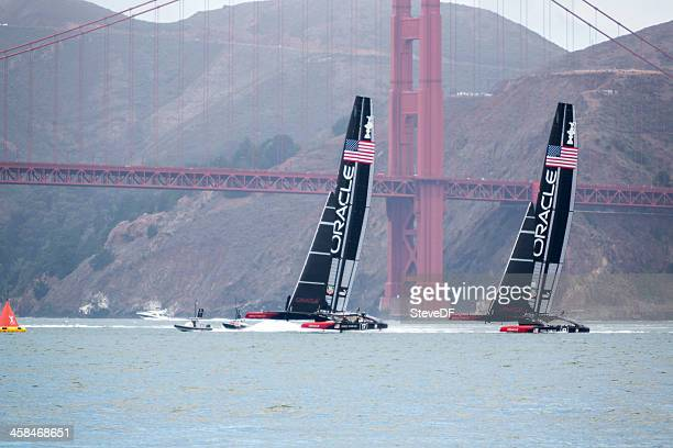 two of oracle team usa's  america's cup catamaran training - catamaran stock photos and pictures