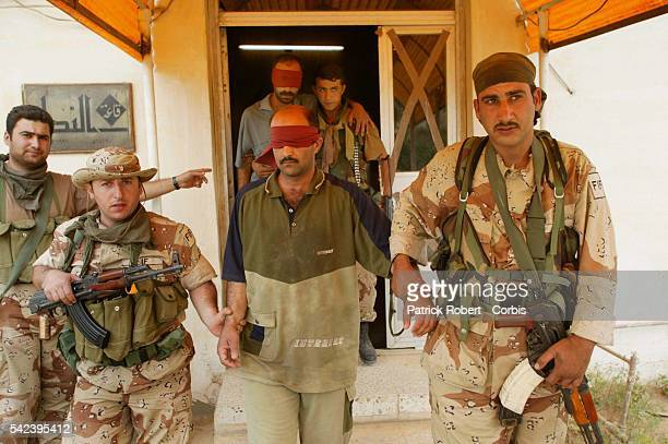 Two of Saddam Hussein's Fedayeen suicide fighters who volunteered to protect him were captured The Free Iraqi Forces brought them to the Iraqi...