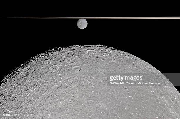 Two of Saturn's Moons Divided by Rings