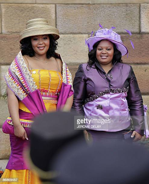 Two of South Africa's newly elected President Jacob Zuma's three wives Thobeka Mabhija and Nompumelelo Ntuli Zuma arrive at the inauguration ceremony...