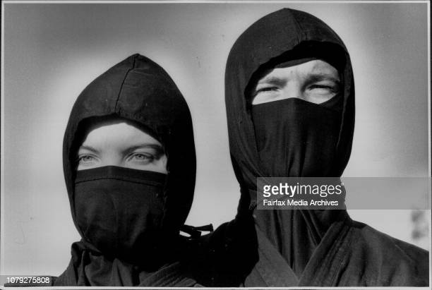 Two of Sydney's Ninjutsu School member's Bradley Stuttle of Doonside and Brenda James of Carlingford perform in their Ninja uniforms July 04 1990