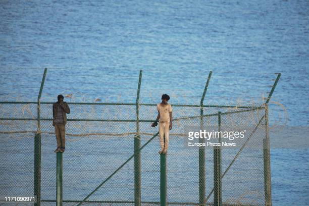 Two of the 153 migrants who have jumped the fence of Ceuta at the first incursion of the year on August 30, 2019 in Ceuta, Spain.