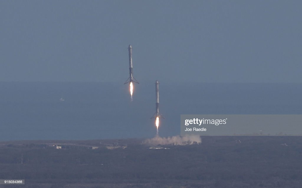 Two of the boosters land at Cape Canaveral Air Force Station after the launch of SpaceX Falcon Heavy rocket from launch pad 39A at Kennedy Space Center on February 6, 2018 in Cape Canaveral, Florida. The rocket is the most powerful rocket in the world and is carrying a Tesla Roadster into orbit.
