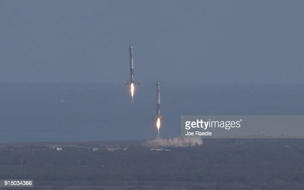 Two of the boosters land at Cape Canaveral Air Force Station after the launch of SpaceX Falcon Heavy rocket from launch pad 39A at Kennedy Space...