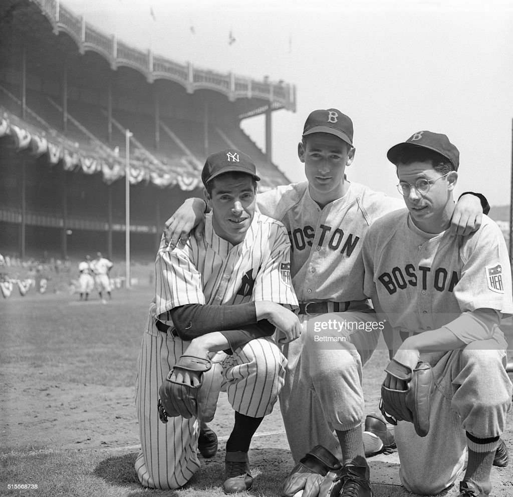 Two of the brothers DiMaggio, Joe, left, of the New York Yankees, and Dominik, right, of the Boston Red Sox, get together with Boston's star outfielder Ted Williams here, before meeting at Yankee Stadium in the New Yorker's first home game of 1942.
