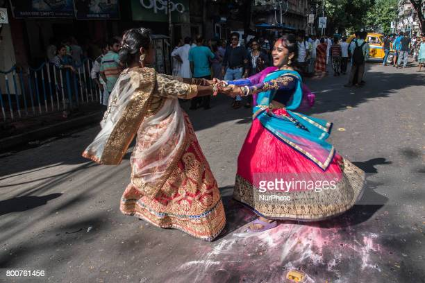 Two of the female devotees of lord jagannath is dancing on the road with joy on the occasion of rathyatra in Kolkata India on 2562017Rath Yatra or...