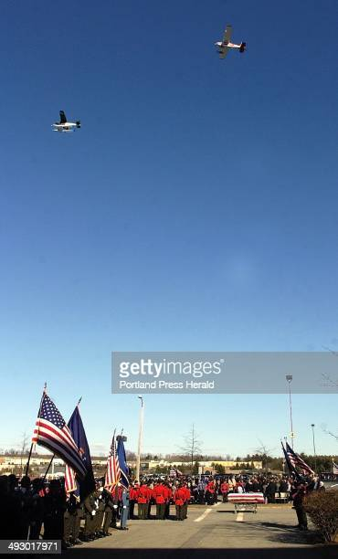Two of the four planes in a missing man formation fly over the Augusta Civic Center at the end of the celebration of life for Warden Service Pilot...