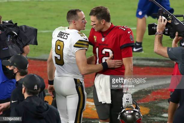 Two of the greatest quarterbacks in NFL history Drew Brees of the Saints and Tom Brady of the Buccaneers share a few words of encouragement after the...