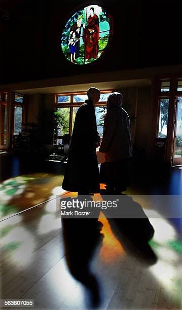 ––Two of the hundreds of faithful followers of Zen Buddhist teacher Thich Nhat Hanh gathered in the main hall at the Deer Park Monastery in Esondidio...