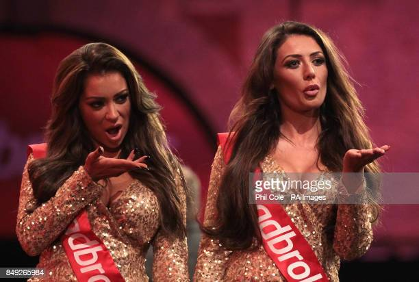 Two of the Ladbrokes walk out girls during the Ladbrokescom World Darts Championship at Alexandra Palace London