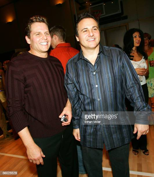 Two of the owners of the NBA's Sacramento Kings team Joe Maloof and his brother Gavin Maloof pose during a party held to introduce the Hardwood Suite...
