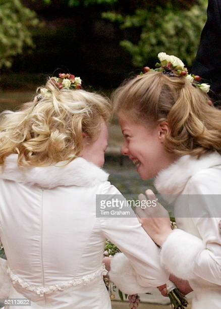 Two Of The Six Bridesmaids Giggling Together After The Wedding Of Lady Tamara Grosvenor And Edward Van Cutsem At Chester Cathedral