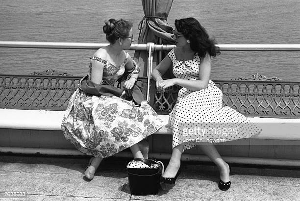 Two of the six women chosen by Picture Post to be 'Picture Post Girls' chatting on the promenade at Eastbourne Their dresses are designed by Alice...