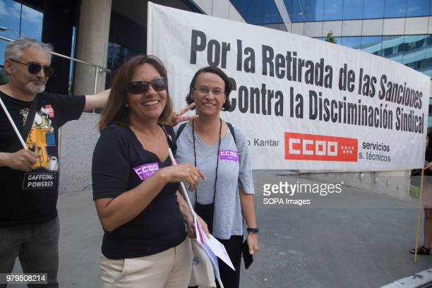 Two of those sanctioned next to the banner Workers protest against the sanctions put by The Human Resources Management of the KANTAR Group sanctions...