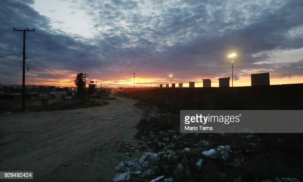 Two of US President Donald Trump's border wall prototypes stand beyond the current border fence as seen from the Mexico side of the US/Mexico border...