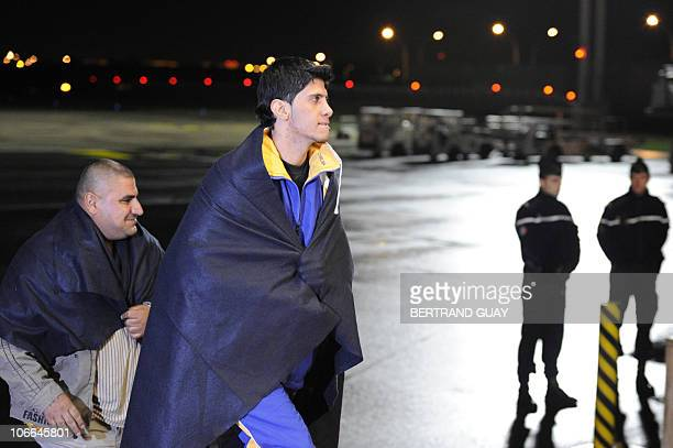 Two of wounded Iraqis arrive in France for hospital treatment on November 8 2010 at Orly airport in Paris The thirtysix Iraqis were wounded during a...