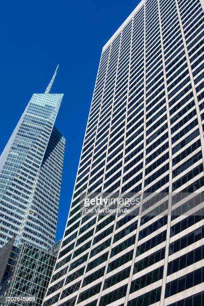 two office building and blue sky - eric van den brulle stock pictures, royalty-free photos & images