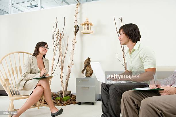 two office workers flirting - feng shui stock photos and pictures