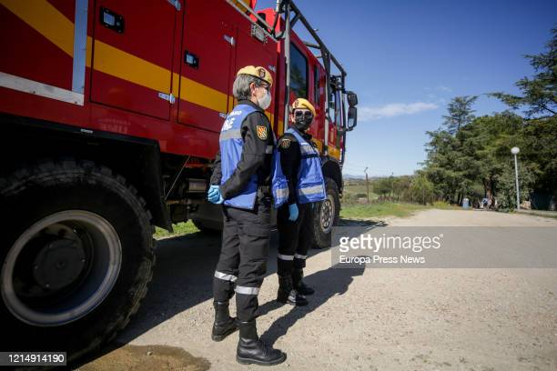 Two officers are seen preparing to disinfect the nursing home San Carlos del Bosque at the town of Villaviciosa de Odon, one of the hundreds of...