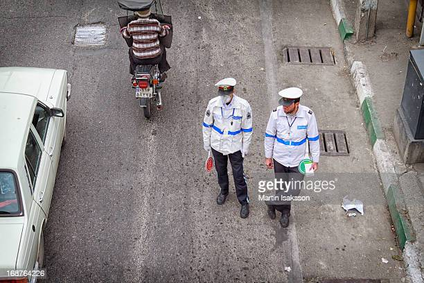 Two officers from the traffic police in Tehran in a street in the Narmak district close to the Sarsabz Metro station. One of the officers are wearing...