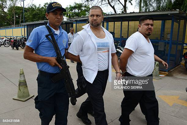 Two officials of Honduras' Immigration administration are arrested during the 'Operation Mesoamerica' in Tegucigalpa on June 28 2016 The operation...
