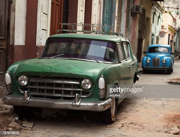 two old classic vintage cuban car - trail of tears stock photos and pictures
