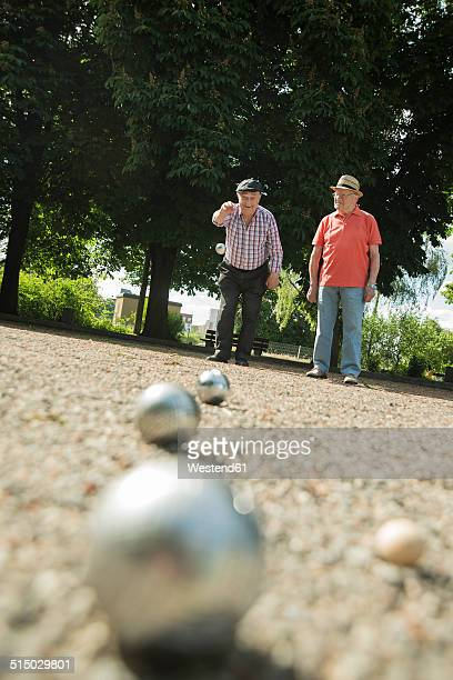 two old friends playing boule in the park - ブール ストックフォトと画像