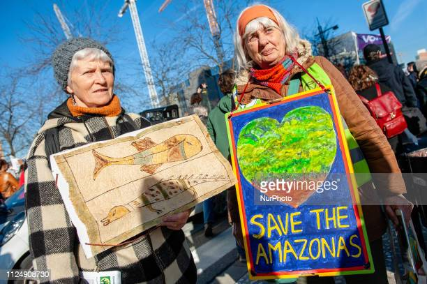 Two old ladies are holding placards during the demonstration for better climate policy in Brussels on February 14th 2019