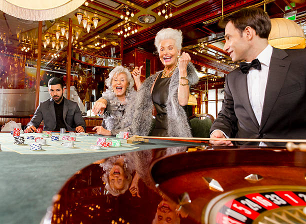 Two old ladies winning at a roulette table
