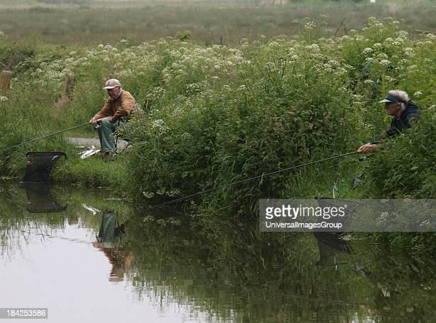 Two old men fishing, Cornwall, UK.