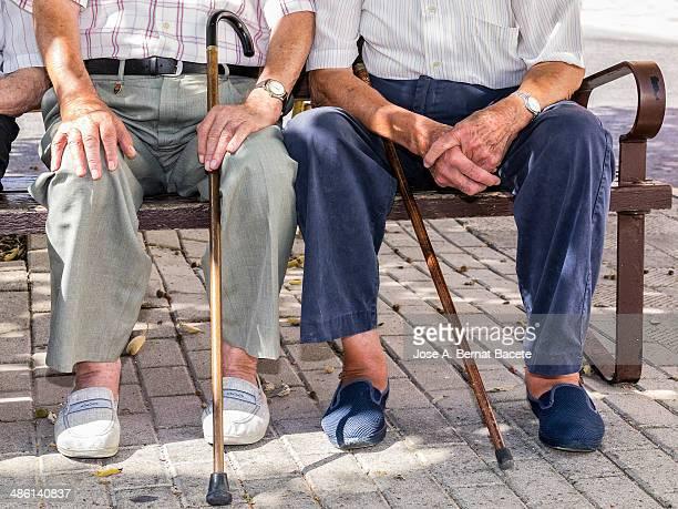 two old men sitting on a park at summer - alleen seniore mannen stockfoto's en -beelden