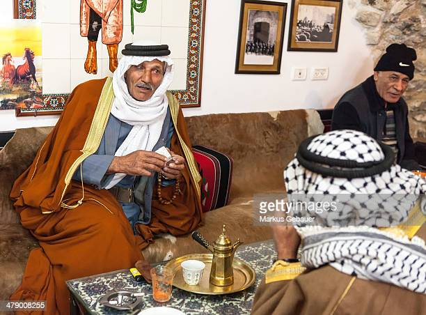CONTENT] Two old men with traditional arabic cloth drinking coffee before muslim friday prayer Jerusalem Old Town Israel