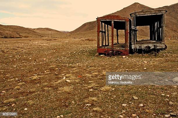 two old train wagons in patagonia - radicella stock pictures, royalty-free photos & images