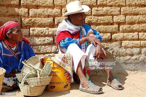 CONTENT] MEZQUITIC JALISCO MEXICO JUNE 11 Two old wixaricas are sitting on the floor during a sunny day in the city of Mezquitic The sale of crafts...