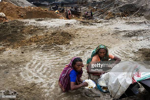 Two old women is taking their lunch during a break within their work inside a stone extraction site on April 4 2015 in Jaflong Sylhet Bangladesh...