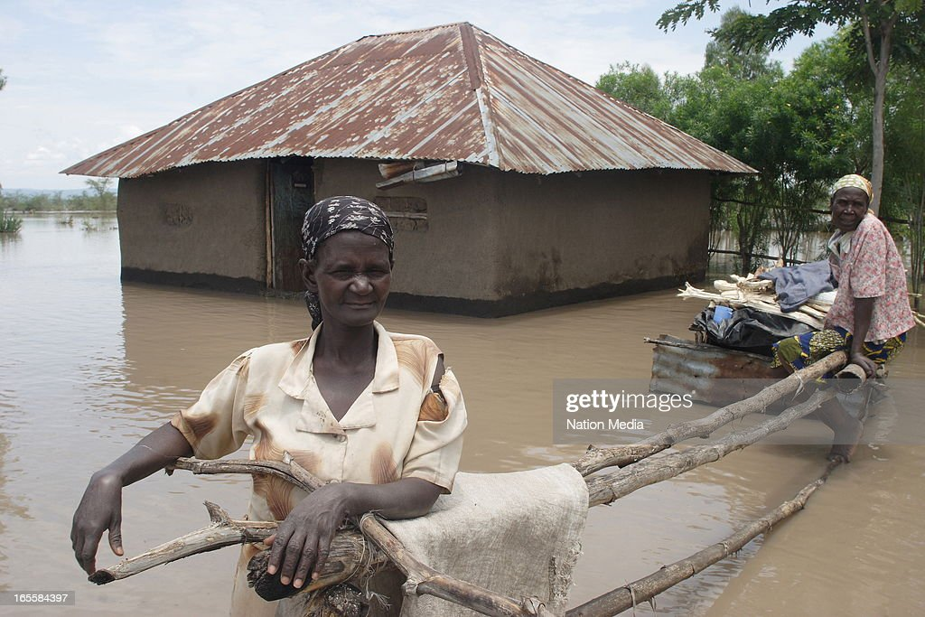 Two old women wait for help after the floods on April 1, 2013 in Kisumu County, Kenya. Thousands of people have been displaced by the heavy rains with houses destroyed and livestock lost. At least 10 people have reportedly been killed by the floods.