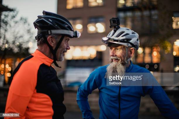 Two Older Cyclists One  Wearing a Helmet Camera