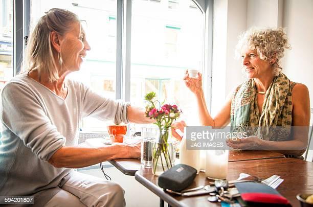 two older women friends in a cafe