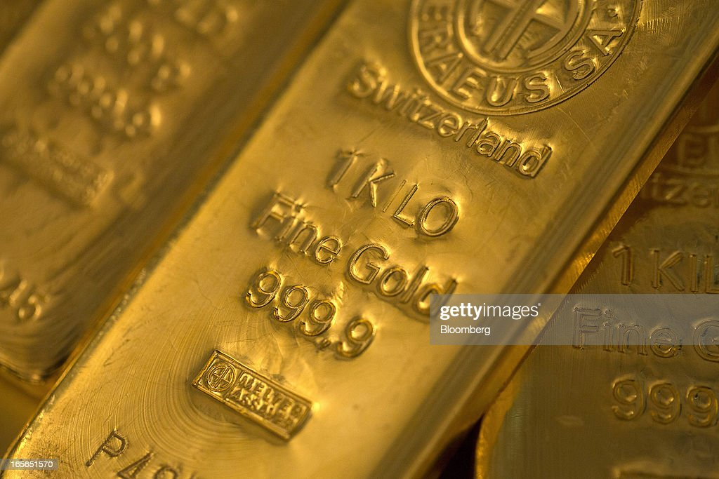 Two one kilogram gold bars sit with a 500 gram gold bar at London bullion dealers Gold Investments Ltd. in this arranged photograph in London, U.K., on Thursday, April 4, 2013. Gold traders are split on whether bullion will plunge into its first bear market since 2008 as economies improve or rally as central banks buy more debt. Photographer: Simon Dawson/Bloomberg via Getty Images